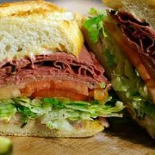 Roast Beef Sandwich cheese, lettuce, tomato and onion.